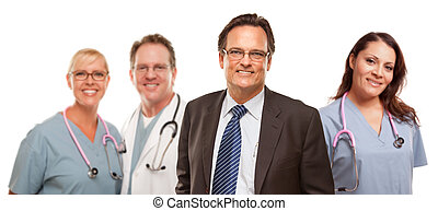 Smiling Businessman with Male and Female Doctors and Nurses
