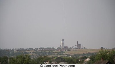 Lightning on the background of the coal mine - Lightning and...