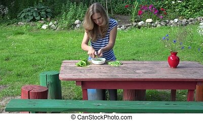 wench girl pod shell green healthy peas on wooden table. 4K...