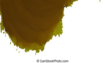 yellow paint flowing down slowly. syrup - close-up view of...