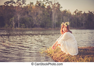 Photo of romantic woman in rain forest