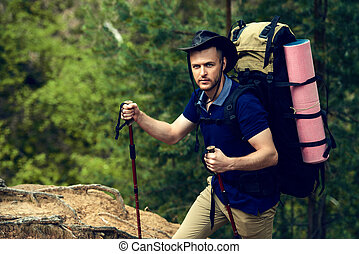 male masculinity - Adventure concept Young man hiking in the...