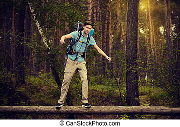 narrow path - Adventure concept. Young man hiking in the...