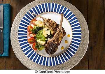 Rare fried rack of lamb with vegetables.