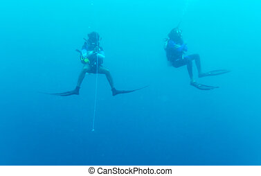 Two divers on 5-min safety stop, Maldives