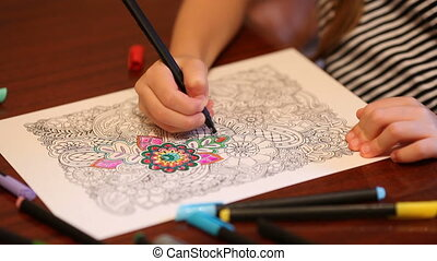 Childs hand painting anti stress colouring with colored felt...