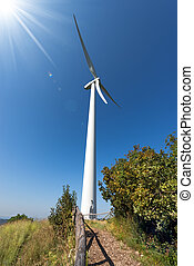 Wind Turbine on a Blue Sky with Sun Rays