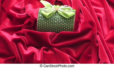 Gift in a box decorated with colorful ribbons