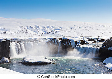 Icelandic natural waterfalls with clear blue sky background