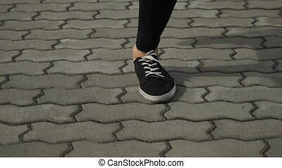 Sports shoes while running closeup