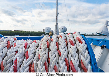 mooring rope ship - mooring rope is wound on board the ship...