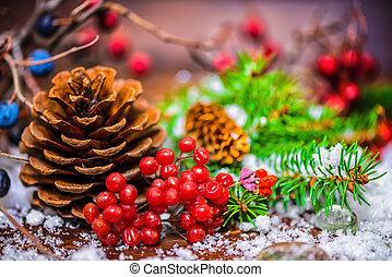 Thanksgiving holiday greeting card with autumn fruit, apple, nuts, cones, berries, fir tree and snow, rural style, close up