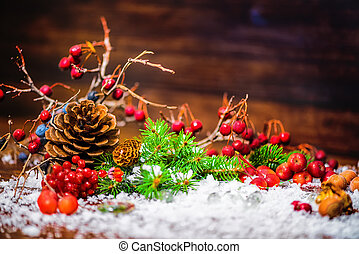 Christmas holiday background with autumn fruit, apple, nuts,...