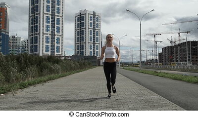 Girl athlete runs down the road