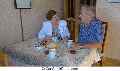 Beautiful couple, happy together, talking at the table. -...