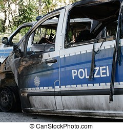 arson attack - Burnt-out cars after an arson attack on...