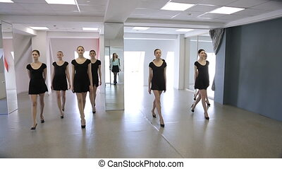 Young models make rehearsal of defile in classroom. They...