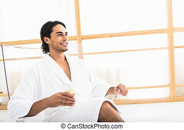 Relaxed man drinking lemonade in morning - Cheerful young...