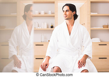 Dreamful guy relaxing at beauty salon - Relaxed young man is...