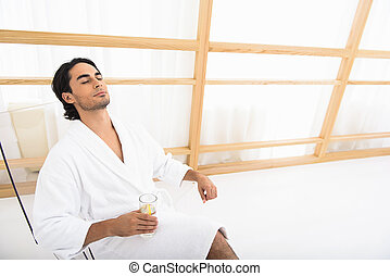 Relaxed guy enjoying his vacation - Young man is relaxing...