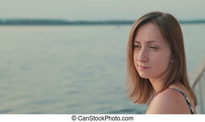 Close up shot of young woman on deck of cruise ship
