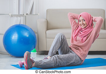 woman stretching while doing exercise at home