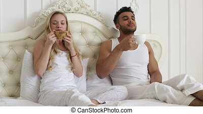 young couple drink coffee in bed, happy smile woman man lovers, love romantic morning