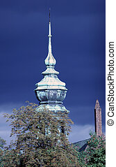 Tower of church on the blue cloudy sky