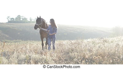 Woman lead horse walking field sunrise cowgirl countryside...