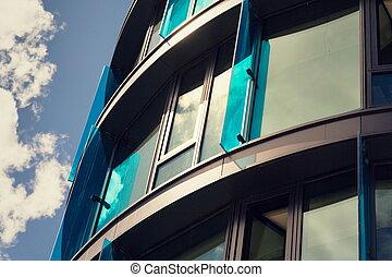 Blue brise soleil sun breakers on modern office glass...