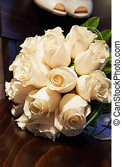 Wedding bouquet a classic round shape from  large cream roses. floristry