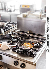 Chef in a commercial kitchen - Professional chef in a...