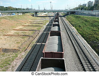goods train with bulk cargo at summer sunny day