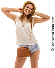 Cheerful young attractive girl in straw hat and denim shorts...