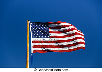 American flag fluttering in blue sky, USA, 2015 - American...