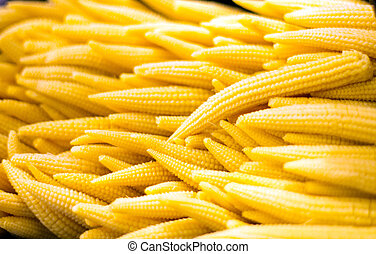 baby corn in salad bar - close up yellow baby corn in salad...