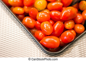 red baby tomato in salad bar - close up red baby tomato in...