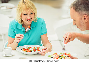 Joyful husband and wife entertaining in restaurant - Happy...