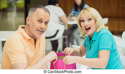 This present is for you - Mature man is giving to his wife a...