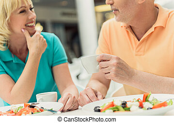 Happy husband and wife resting in cafeteria - Joyful married...