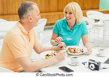 Happy married couple dining in restaurant - Cheerful senior...