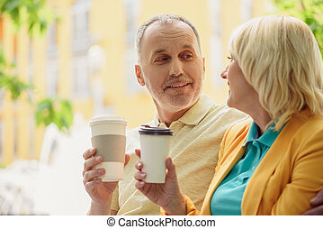 Mature husband and wife enjoying hot drink - Senior married...