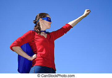 Superhero mother against blue sky background with copy...