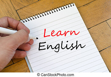 Learn english text concept - White notepad and human hand on...