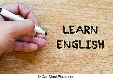 Learn english text concept - Human hand over wooden...