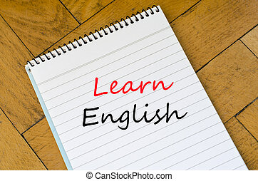 Learn english text concept - White notepad on the wooden...