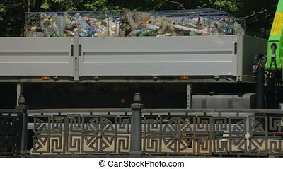 Truck With Garbage Driving Along River Bank - In the frame...
