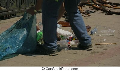 Volunteers Collecting Garbage From River