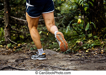 running marathon runner in woods