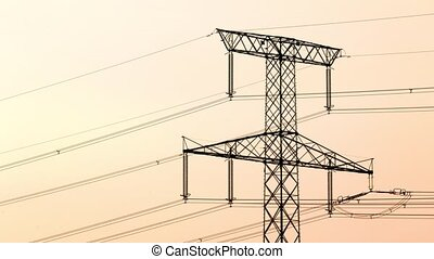 Time lapse footage of electricity pylon at sunset - Time...